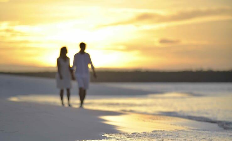 Family safari specialists - Mike and Tess walking andbeyond mnemba island Zanzibar sunset