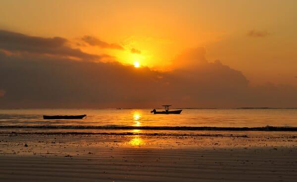Kenya coast Diani sunrise boats beach family safari