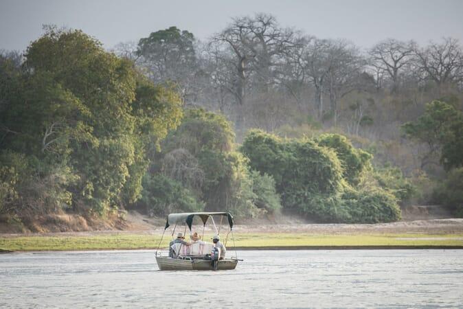 Tanzania Nyerere Sand Rivers Selous family safari boat
