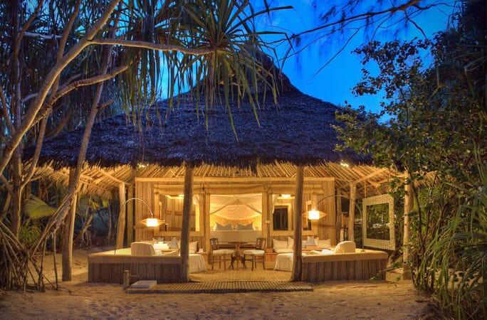 Tanzania Zanzibar Mnemba family safari banda exterior night