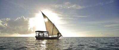 Tanzania Zanzibar andBeyond Mnemba island family safari sunset dhow