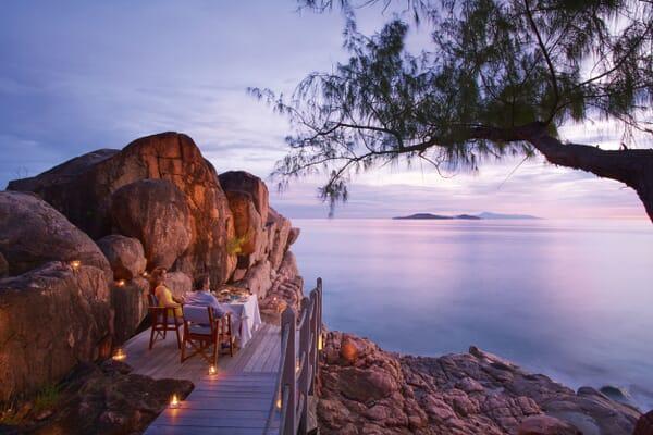 Praslin luxury family holidays - Constance Lemuria dinner on rocks