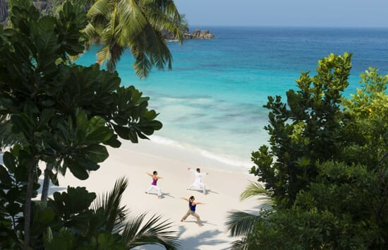 Mahe luxury family holidays - Four Seasons beach yoga